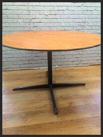 Large circular wood and metal table