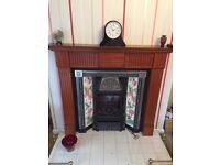 Cast iron tiled fireplace with wood surround and remote controlled gas fire