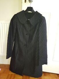 Size 10 back knee length Untold coat