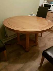 4ft solid oak table and 6 brown faux leather chairs