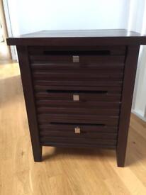 Dark wood three drawer side table