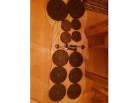 Weights 6x10kg iron, 4x5kg iron, 2x10kg plastic, 2xbarbells