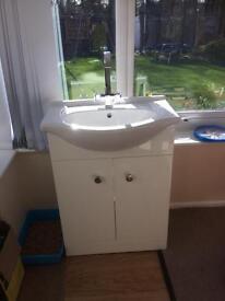 White sink wash basin with soft close cupboard