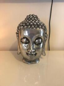Silver Buddha head accessory