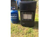 1 portable 'lifestyle' 4.2kg calor gas heater with 2 calor gas 15kg bottles, 1 installed.