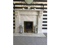 great looking marble fireplace and fire to go with it