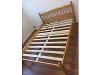 Solid pine double bed and mattress - like new