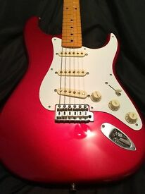 Fender Stratocaster. MIM Rare Nitro 50's Version with lighly flamed neck and tweed case. Stunning.