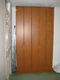 Nolte Mobel wardrobe with folding doors.