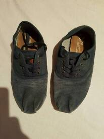 2 pairs of Tom's size 7