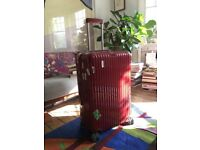 Large Red Rimowa Suitcase