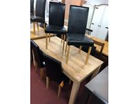 stain oak table and 6 black leather chairs
