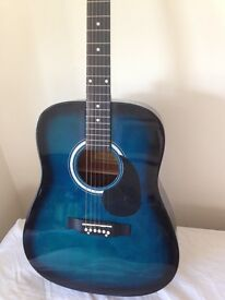An ideal beginners acoustic guitar As new! Full size with good strong case