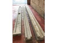 """7' concrete corner post, 7' straight post and 6"""" x 6' concrete gravel board."""