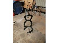Horse shoes wine rack