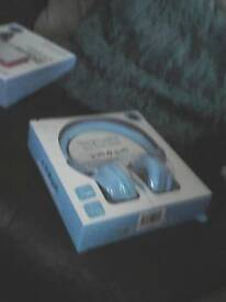 Headphones new in box bkue wired