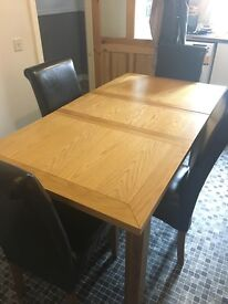 Oak kitchen table with leather chairs