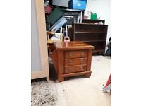 Solid coffee table with drawers for videos or magazines, on wheels
