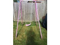 Pink and white Chad valley child's swing.