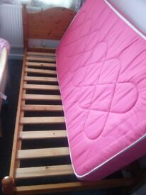 """Solid pine single (3'6"""") with mattress. The mattress has been under a waterproof protector."""