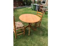 Pine pedestal breakfast table and two chairs (can deliver)