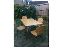 Lovely Wooden Table with Metal Legs Plus 4 Chairs
