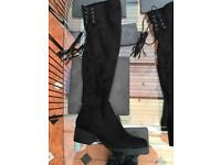 New black knee high boots