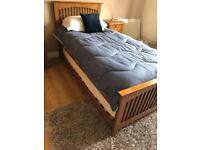 "Wooden single ""trundle"" bed"