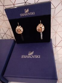 GENUINE SWAROVSKI BELLA V EARRINGS 18CT YELLOW GOLD. GOLDEN SHADOW CRYSTAL. NEW / CERTIFICATE / BOX.
