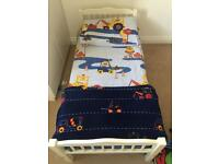 White toddler bed, next diggers bedding set, matching rug and lined curtains