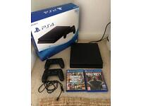 PS4 Slim 500gb with 2 controllers and 2 games