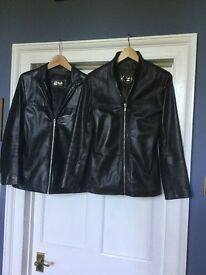 One black and one brown leather jackets