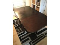 Dark hard wood extendable dining table