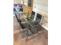 Glass dining table and 6 x chairs (Next)