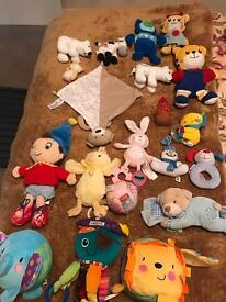 Baby bundle of soft toys include bibs and rattles