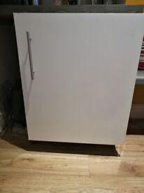 Under counter freezer with cupboard door