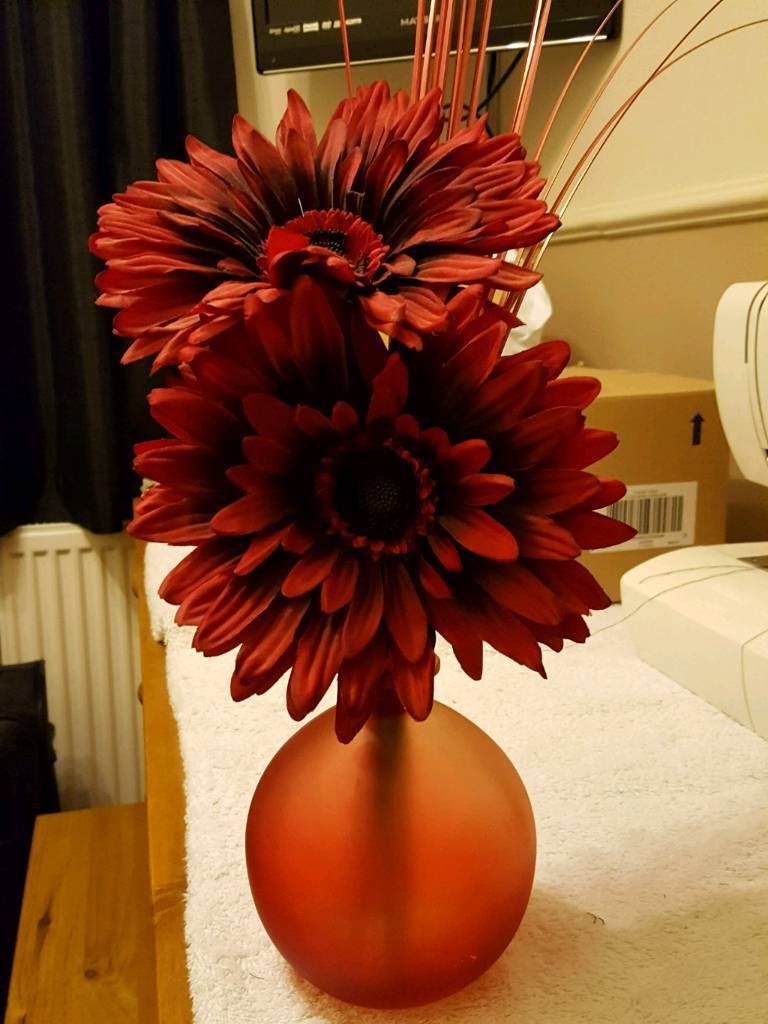 Red flowers in vase REDUCED