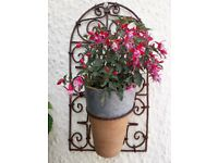 VINTAGE ORNATE IRON METAL PLANT HANGER WITH TERRACOTTA POT. AXMINSTER £15 EACH OR BOTH FOR £25