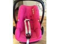 Less than a year old. bright pink maxi cosi car seat rear facing in good condition