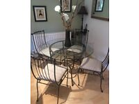 IMMACULATE IRON TABLE WITH GLASS TOP, INCLUDING 4 MATCHING CHAIRS