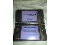 Nintendo DSi XL with games and charger