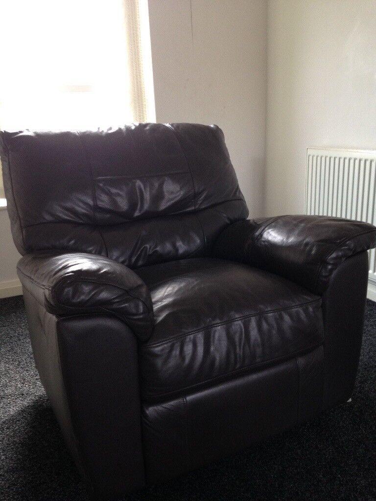 Dark brown leather reclining arm chair