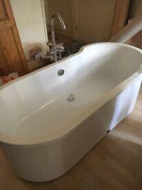 Oversized bathtub with beautiful swan taps