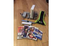 Nintendo Wii (White) with 4 games, Zumba belt, 1 remote, Sensor, Stand, Power pack etc