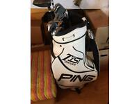 Left handed Wilson golf clubs with bag