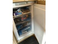 Integrated undercounted freezer
