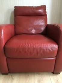 Red Natuzzi Italian leather reclining armchair