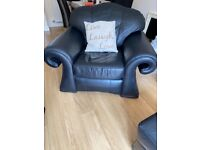 Two seater leather sofa, chair and large foot stool