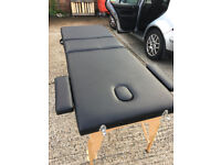 Massage table folding type. no bag but has arm and face sections