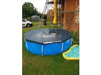 Swimming pool with pump and lid